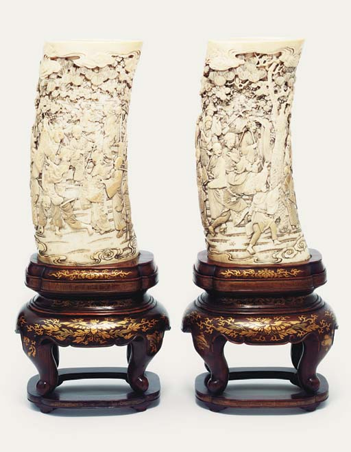 A pair of ivory tusk vases