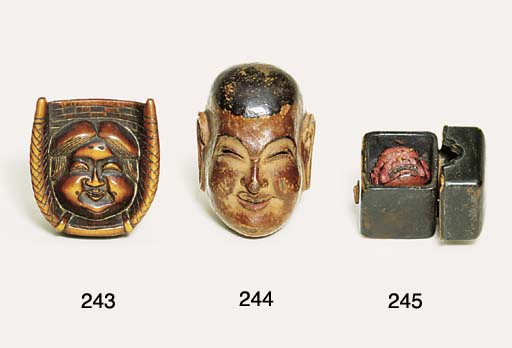 A wood mask netsuke