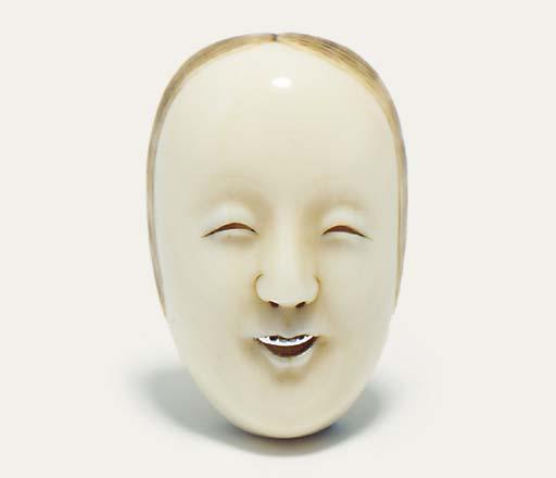 An unusual ivory mask netsuke
