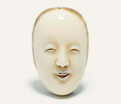 An unusual ivory mask netsuke