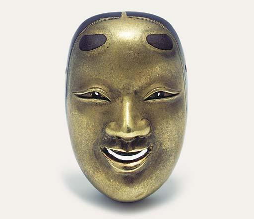 A gold mask netsuke