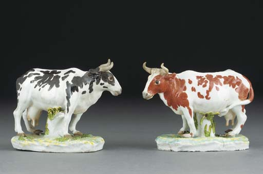 Two Meissen models of cows