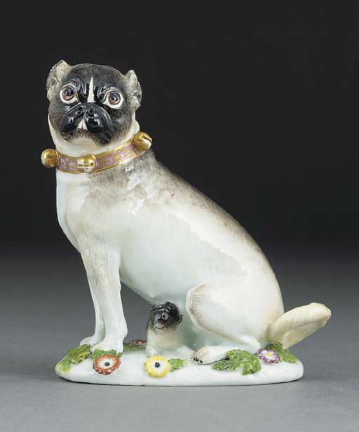 A Meissen group of a pug bitch