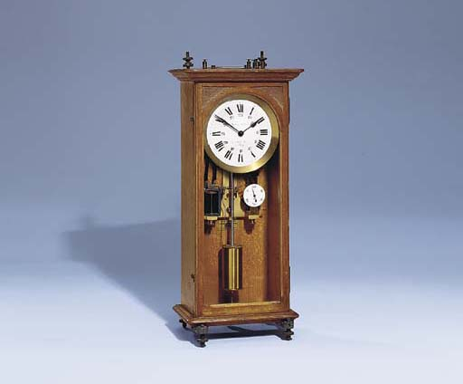 A French oak small electric timepiece