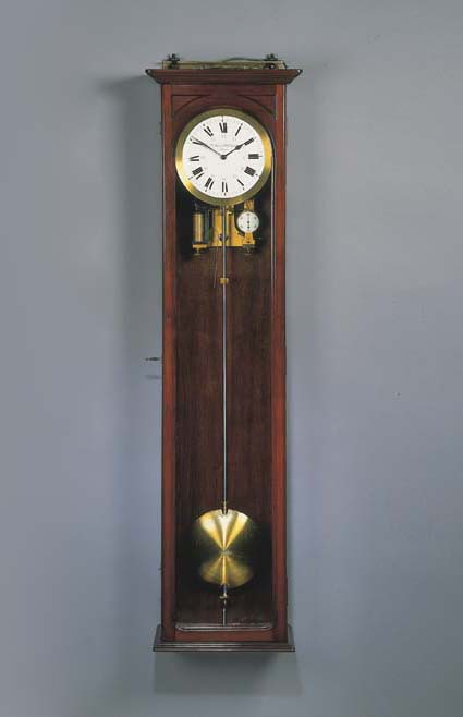 A FRENCH MAHOGANY ELECTRIC WALL REGULATOR