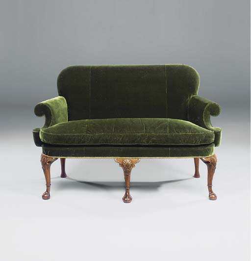 A GEORGE II WALNUT SETTEE