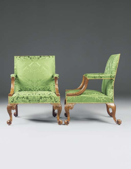 A PAIR OF GEORGE II WALNUT LIBRARY OPEN ARMCHAIRS