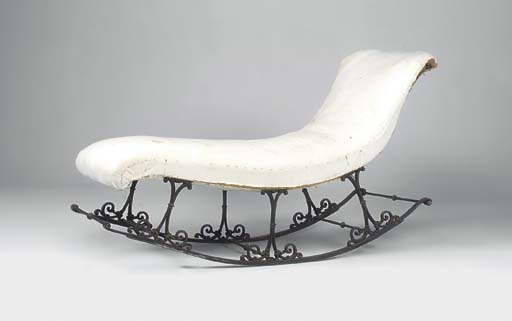 A WROUGHT AND CAST IRON ROCKIN