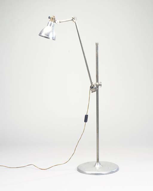 AN ADJUSTABLE GRAS FLOOR LAMP