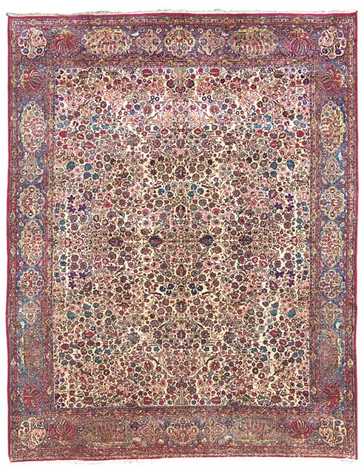 A SILK KASHAN CARPET