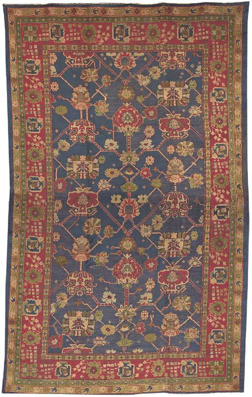 A DONEGAL OF CARPET OF USHAK DESIGN