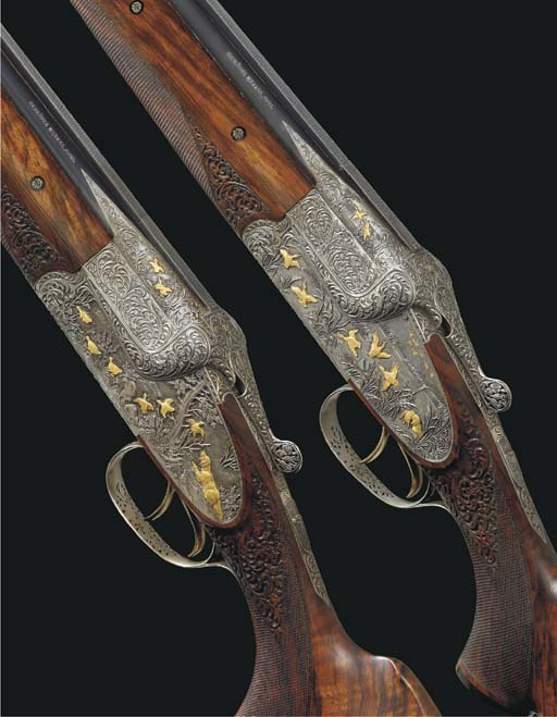 A FINE AND ORNATE PAIR OF 12-B