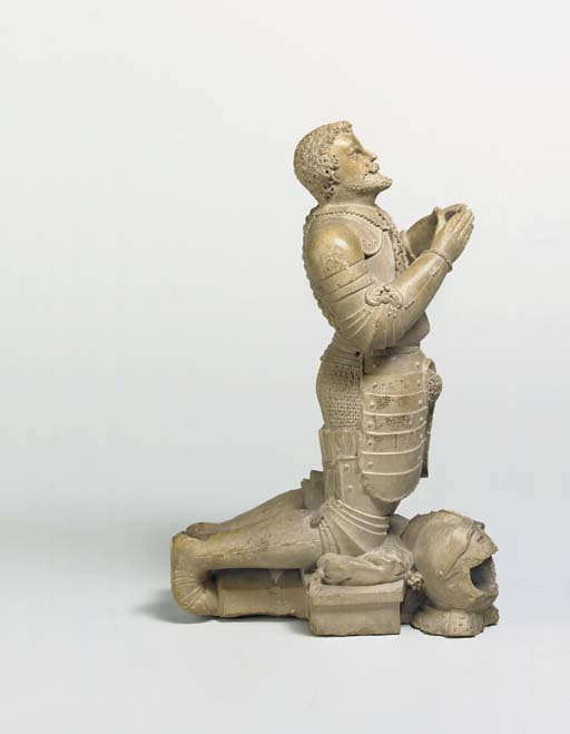 A CARVED STONE FIGURE OF A MIL