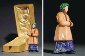A carved hardstone model of a peasant woman