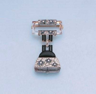 AN ART DECO DIAMOND, ONYX AND