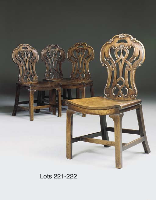 A PAIR OF LATE GEORGE II MAHOGANY HALL CHAIRS