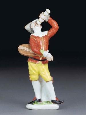 A Meissen figure of Harlequin