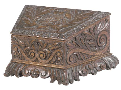 A VICTORIAN CARVED OAK LETTERB