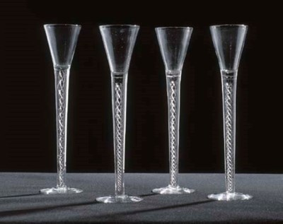 FOUR DRAWN-TRMPET WINE GLASSES
