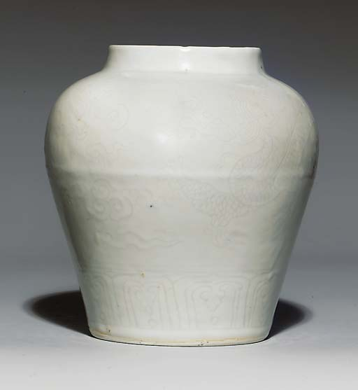A WHITE-GLAZED 'DRAGON' JAR, G