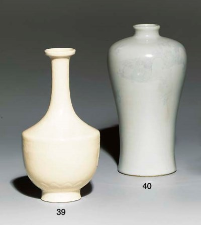 AN INCISED WHITE-GLAZED AND UN