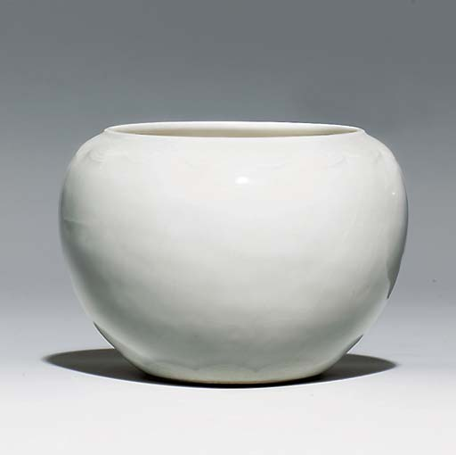 A SOFT-PASTE WHITE-GLAZED 'ALM