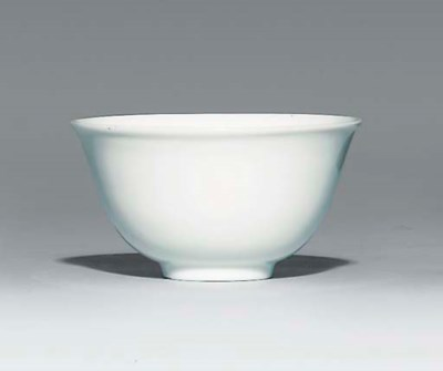 A SMALL WHITE-GLAZED CUP