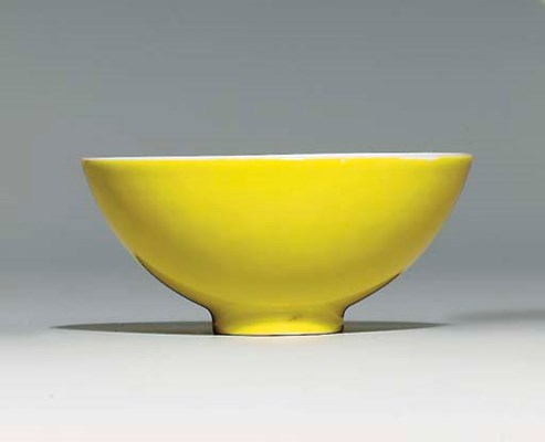 A LEMON-YELLOW-ENAMELLED CUP