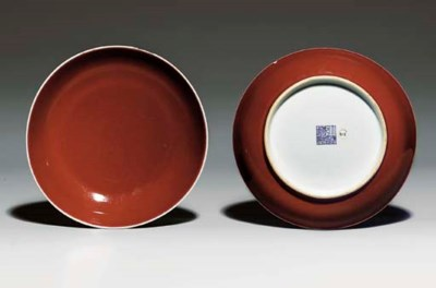 A PAIR OF COPPER-RED-GLAZED DI
