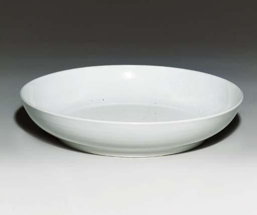 A LARGE WHITE-GLAZED DISH