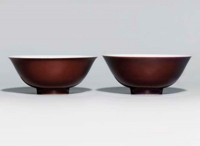 A PAIR OF COPPER-RED-GLAZED BO
