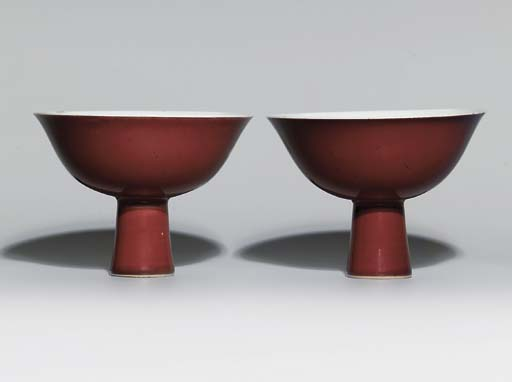A PAIR OF COPPER-RED-GLAZED ST