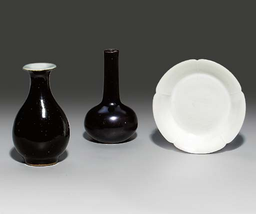 A SMALL WHITE-GLAZED DISH; AND
