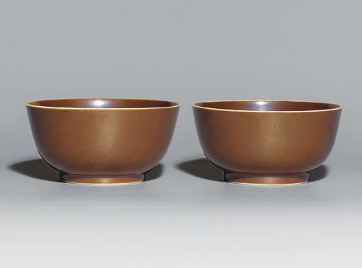 A PAIR OF BROWN-GLAZED BOWLS