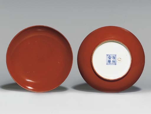 A PAIR OF CORAL-GLAZED SAUCERS