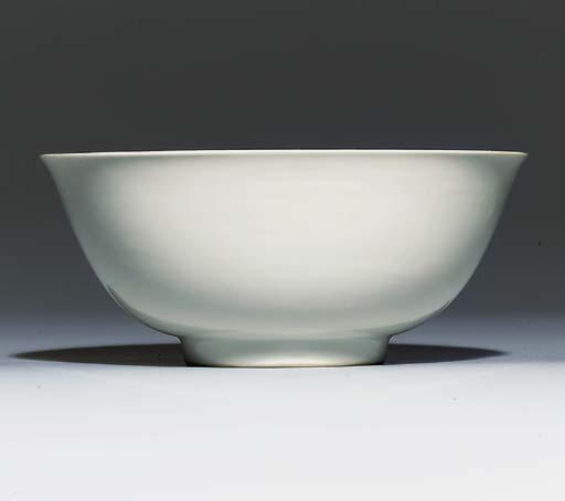 A WHITE-GLAZED BOWL