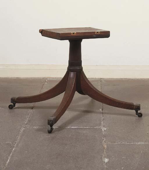 A REGENCY MAHOGANY TABLE PEDES