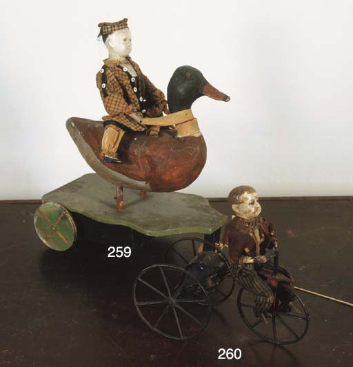 A VICTORIAN PULL-ALONG DUCK TO