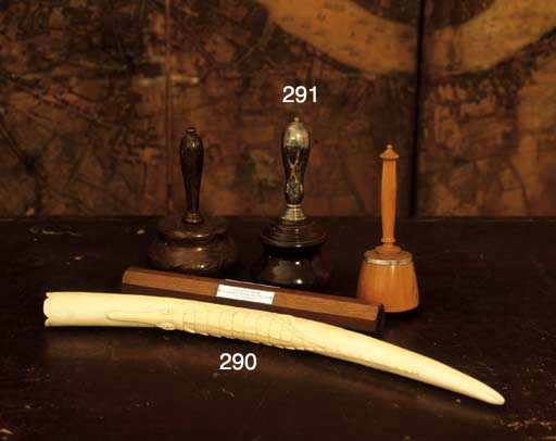 AN IVORY TUSK SECTION CARVED W