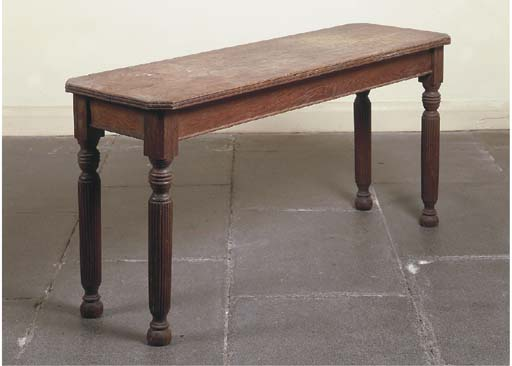 A MID-VICTORIAN OAK TABLE