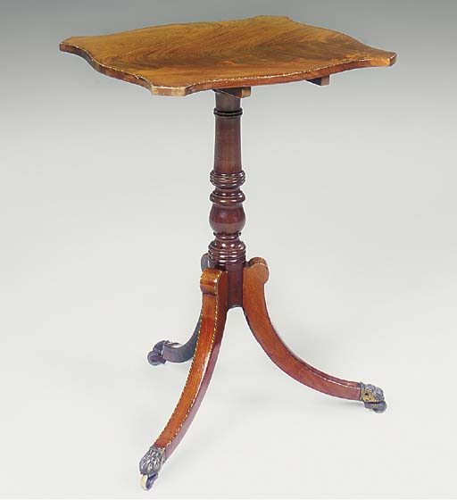 A REGENCY MAHOGANY AND CHEQUER