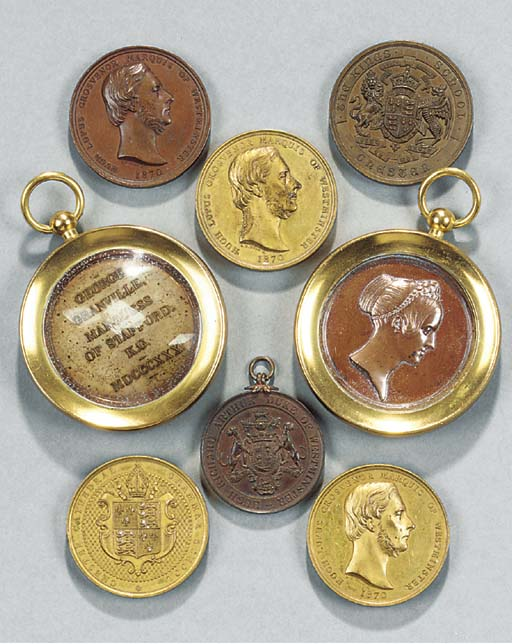 A GROUP OF EIGHT GILT-METAL BR