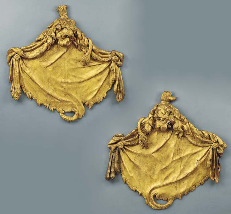 A PAIR OF GEORGE II CARVED GIL