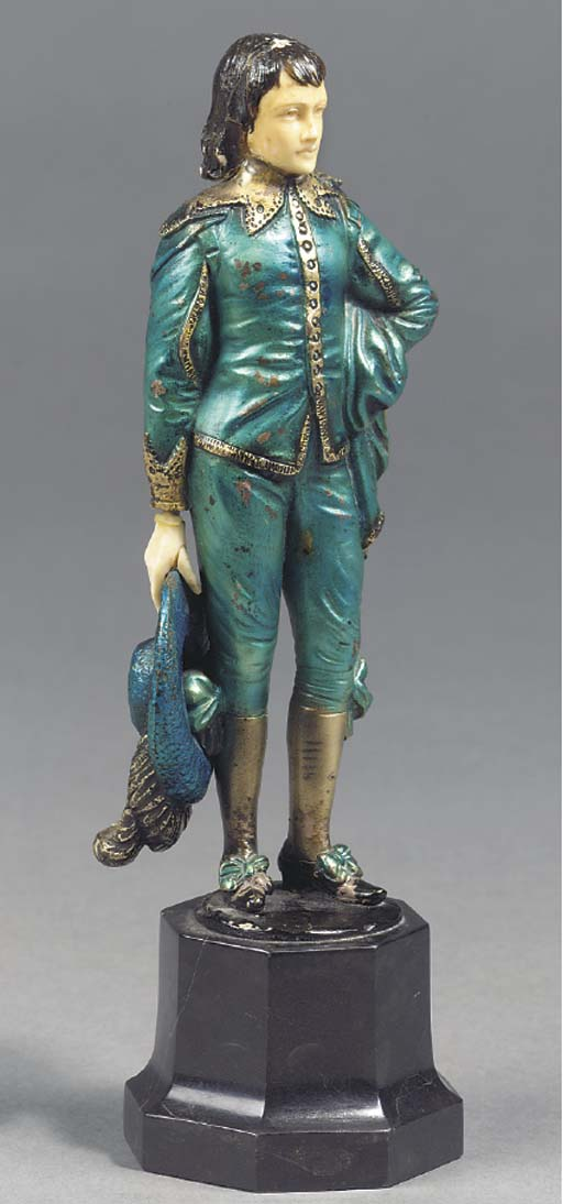 A COLD PAINTED BRONZE AND IVOR