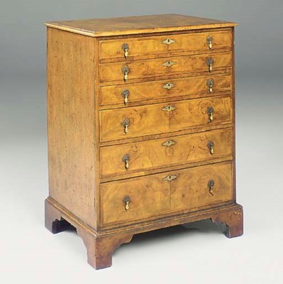 A WALNUT AND OAK CHEST