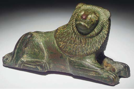 A GREEK BRONZE FIGURE OF A REC