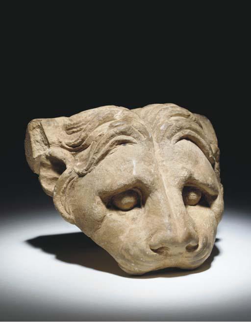 A GREEK LIMESTONE LION HEAD