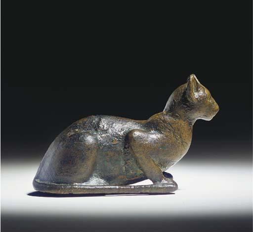 AN EGYPTIAN SOLID CAST BRONZE