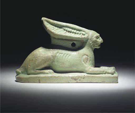 AN EGYPTIAN GREEN FAIENCE AMUL