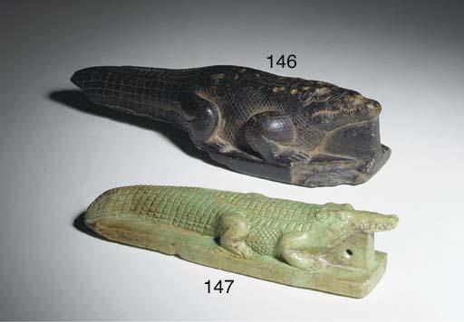 AN EGYPTIAN STEATITE FIGURE OF